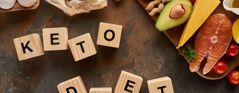 High Fat Foods Near Wooden Cubes With Ketogenic Diet Inscription